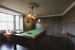 MAKE YOUR AIRBNB STAND OUT WITH A FULLY STOCKED GAME ROOM